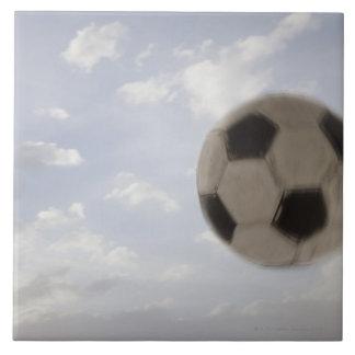 USA, Utah, Lehi, Soccer ball against sky Ceramic Tile