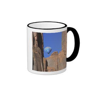 USA, Utah, Monument Valley. A rainbow hot-air Ringer Coffee Mug