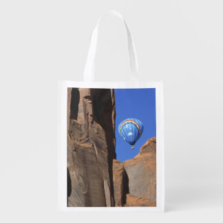 USA, Utah, Monument Valley. A rainbow hot-air Reusable Grocery Bags
