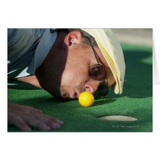 USA, Utah, Orem, Man blowing air to push golf Card