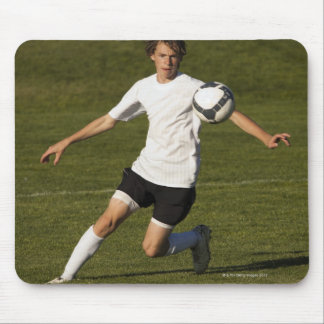 USA, Utah, Orem, teenage (14-15) boy playing Mouse Pad