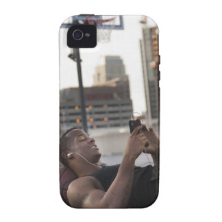 USA, Utah, Salt Lake City, Young man lying on Case-Mate iPhone 4 Covers