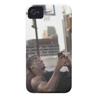 USA, Utah, Salt Lake City, Young man lying on Case-Mate iPhone 4 Cases