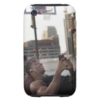 USA, Utah, Salt Lake City, Young man lying on Tough iPhone 3 Case