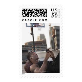 USA, Utah, Salt Lake City, Young man lying on Postage