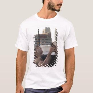 USA, Utah, Salt Lake City, Young man lying on T-Shirt