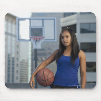 USA, Utah, Salt Lake City, young woman holding Mousepad