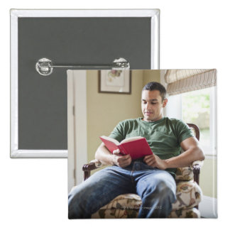 USA, Utah, Young man reading book 2 Inch Square Button
