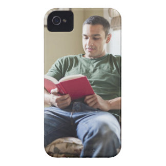 USA, Utah, Young man reading book iPhone 4 Case-Mate Case