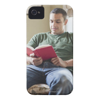 USA, Utah, Young man reading book iPhone 4 Case-Mate Cases