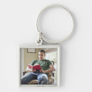 USA, Utah, Young man reading book Keychain