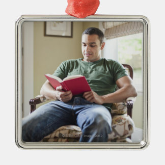 USA, Utah, Young man reading book Metal Ornament