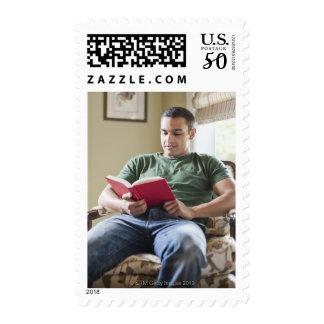 USA, Utah, Young man reading book Postage