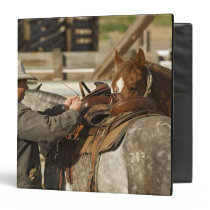 USA, Washington, Malaga, Cowboy preparing for 3 Ring Binder