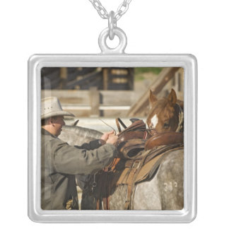 USA, Washington, Malaga, Cowboy preparing for Silver Plated Necklace
