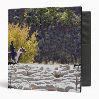 USA, Wyoming, Evanston. Cowboy herding sheep. Vinyl Binder