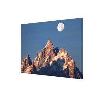 USA, Wyoming, Grand Teton NP. A full moon sets Canvas Print