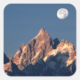 USA, Wyoming, Grand Teton NP. A full moon sets Square Sticker