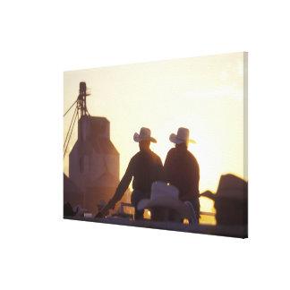 USA, Wyoming, Pine Bluffs. Two men shake Canvas Print