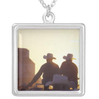 USA, Wyoming, Pine Bluffs. Two men shake Silver Plated Necklace