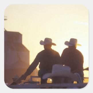 USA, Wyoming, Pine Bluffs. Two men shake Square Sticker