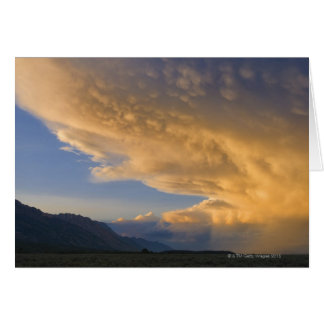 USA, Wyoming, Storm clouds over plains at sunset Card