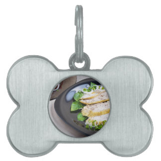 Useful and tasty homemade dinner of baked chicken pet ID tag