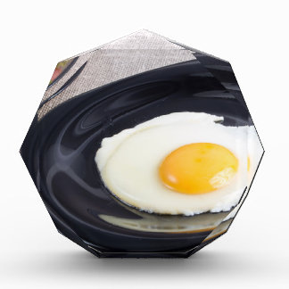 Useful homemade breakfast of fried egg and a salad acrylic award