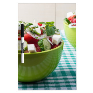 Useful vegetarian food from raw tomatoes, cucumber dry erase board