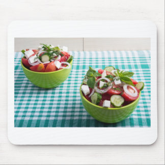 Useful vegetarian food from raw tomatoes, cucumber mouse pad