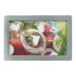 Useful vegetarian salad with raw tomatoes belt buckle
