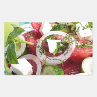 Useful vegetarian salad with raw tomatoes rectangular sticker