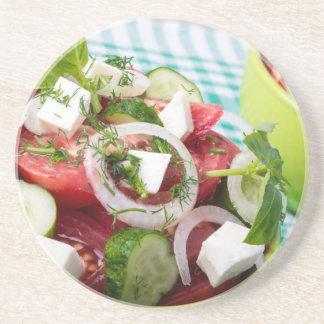 Useful vegetarian salad with raw tomatoes sandstone coaster