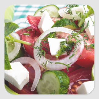 Useful vegetarian salad with raw tomatoes square sticker