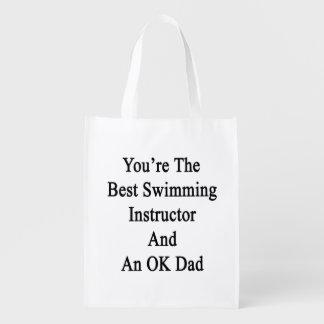 Usted es el mejor instructor de la natación y un bolsa reutilizable