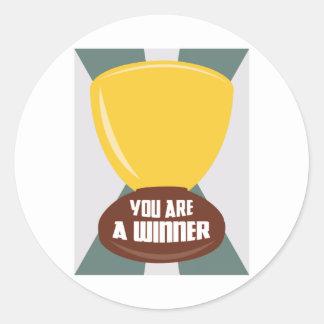 Usted es un ganador pegatina redonda