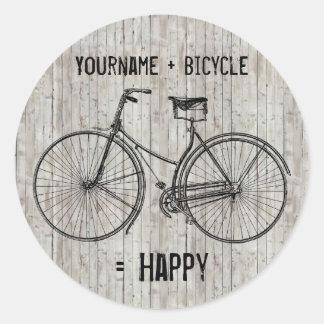 Usted más la bicicleta iguala el tablón de madera pegatina redonda