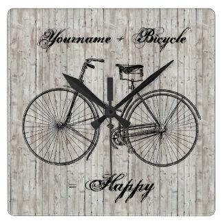 Usted más la bicicleta iguala el tablón de madera  relojes de pared