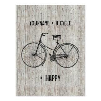 Usted más la bicicleta iguala el tablón de madera postal