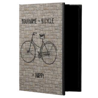 Usted más la bicicleta iguala los ladrillos antigu