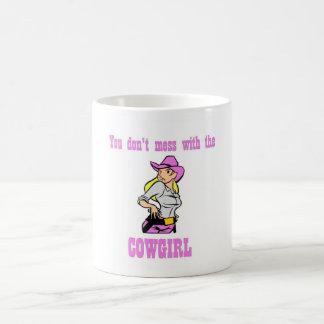 Usted no ensucia con la taza de la vaquera