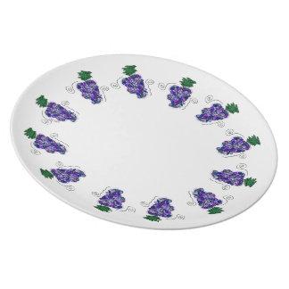 Uvas banales plato de cena