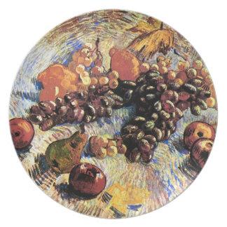 Uvas de los limones de las peras de las manzanas d plato de comida