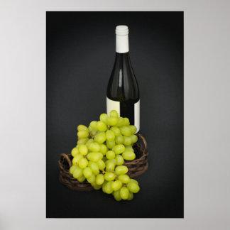 uvas en una cesta y una botella de vino posters