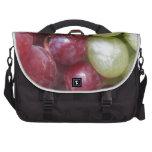 Uvas mezcladas bolsas de portatil