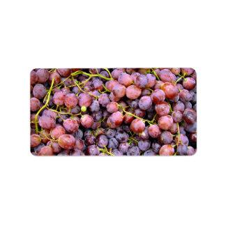 Uvas rojas frescas del globo etiqueta de dirección