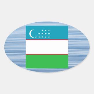 Uzbek Flag Floating on water Oval Sticker