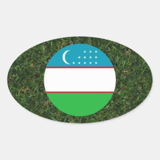 Uzbekistan Flag on Grass Oval Sticker