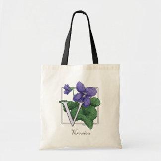 V para el monograma de la flor de las violetas bolsa