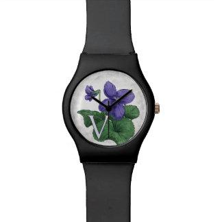 V para las ilustraciones del monograma de la flor relojes de pulsera